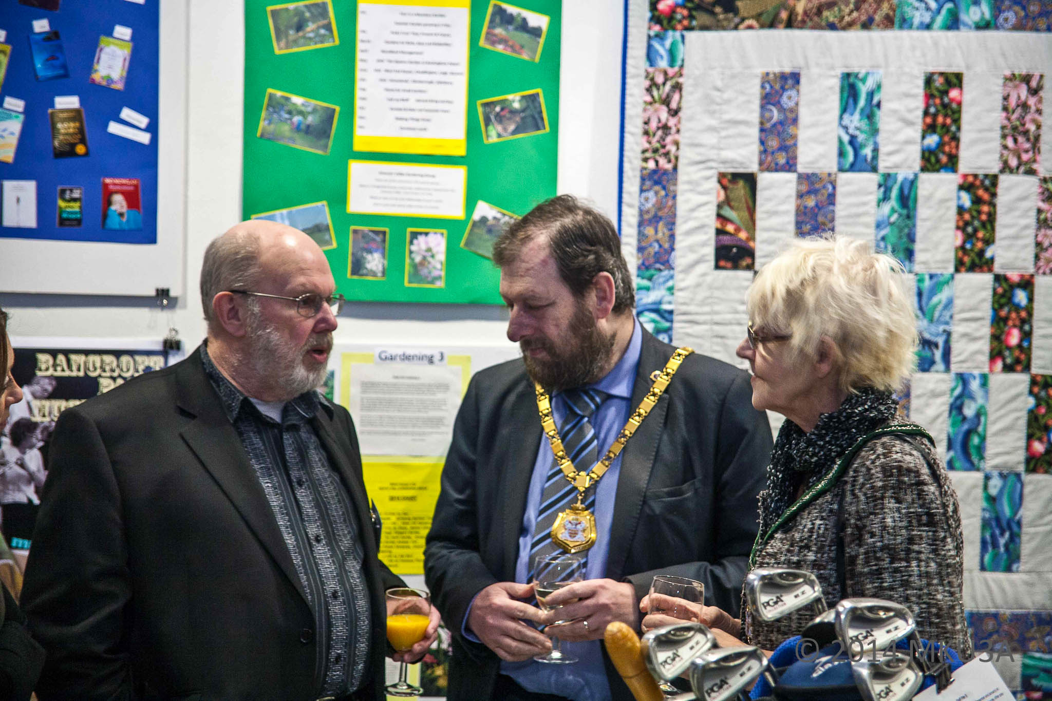 The Mayor of Milton Keynes, Councillor Brian White and Mayoress, Mrs Leena Lindholm-White talk with MKU3A Webmaster Derek Barrett about the exhibition